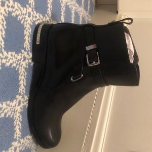 A brand new MK black hi top shoes